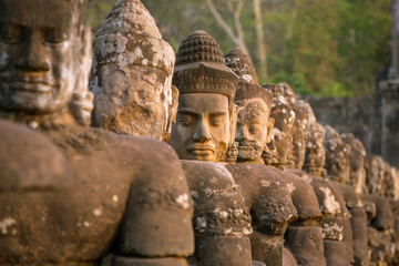 Stone carved statues of Devas on the bridge to Angkor Thom in An