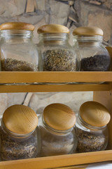 Spice jars - Assorted spice jars on a shelf.