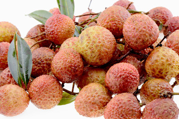 Fresh lychee fruits on a white background