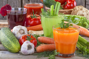 Healthy vegetable juices of carrot, celery, beetroot and tomato