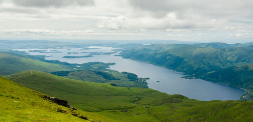 View of Loch Lomond from the top of Ben Lomond in a sunny  day.