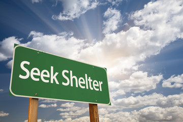 Seek Shelter Green Road Sign