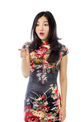 Shocked Asian young woman with pointing isolated on white