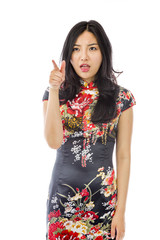 Asian young woman with pointing isolated on white background