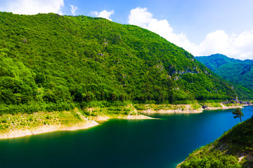 Mountain lake.  Beautiful landscape with lake, forest and mounta