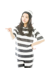 Young Asian woman showing something in prisoners uniform