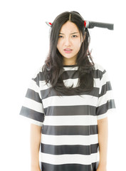 Sad Asian young woman wearing knife shaped hair band in