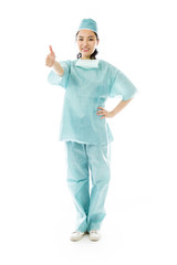Asian female surgeon making thumbs up sign standing with hand on