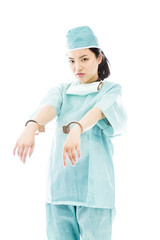 Asian female surgeon in blue uniform with handcuffed hands