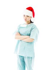 Upset Asian female surgeon wearing Santa hat