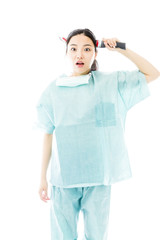 Shocked Asian female surgeon wearing knife shaped hair band