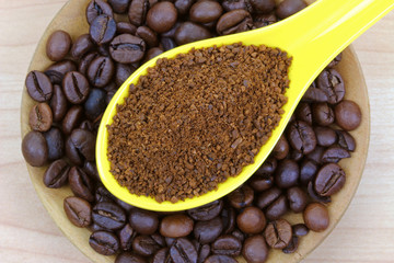 Freshly ground coffee on coffee beans