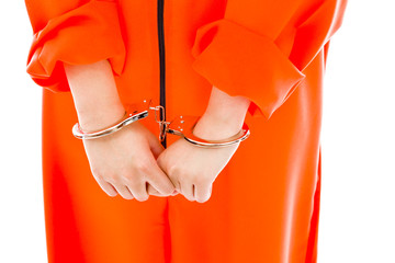 Midsection of a handcuffed Asian young woman in prisoners