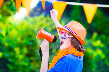 Dutch football fan, little cute boy cheering