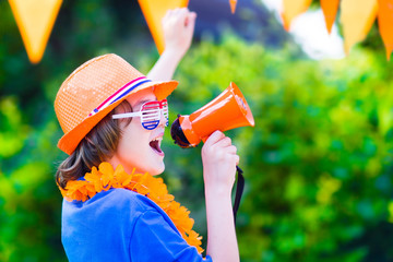 Dutch football fan, little nice boy cheering