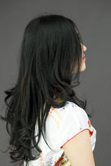 Rear view of an Asian young woman looking up