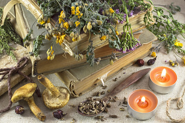 Still life with healing herbs and candles