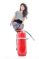 young girl with leg on fire extinguisher
