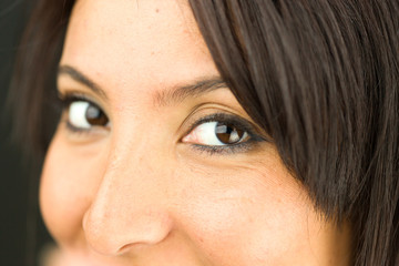 Extreme close-up of a young woman smiling