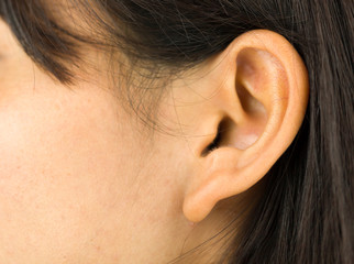 Extreme close-up of a young woman's ear