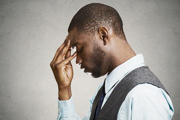 Side profile portrait  sad, depressed businessman, young guy