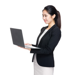 Business woman look at computer