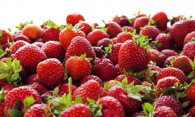 Strawberries tumbling, close up, focus in the middle distance.