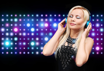 Young DJ Woman with Headphones. Happy Blonde Girl