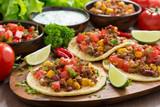 Mexican cuisine - tortillas with chili con carne, tomato salsa