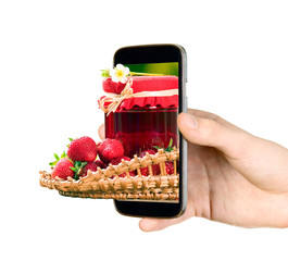 Man is showing strawberries through mobile phone