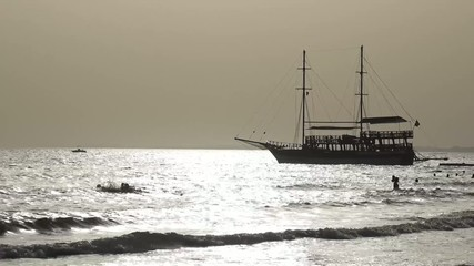 Sailing ship and surf on the beach