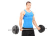 Muscular athlete holding a barbell