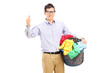 Man holding a laundry basket and giving thumb up