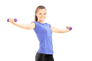 Joyful woman exercising with dumbbells