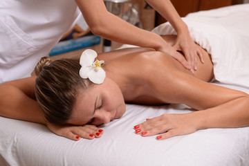 Young lady getting back massage