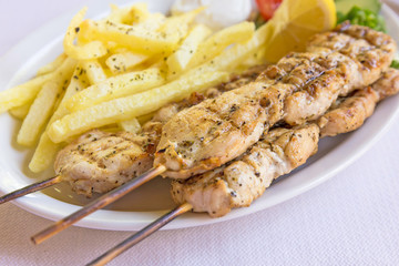 chicken kebab (sulvaki) on wooden skewers