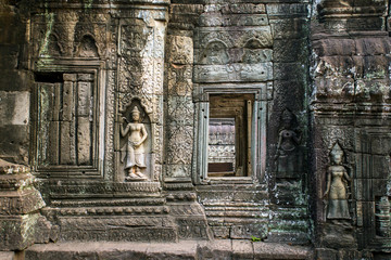 Apsara, stone carvings on the wall of Angkor Ta Prohm temple, Si