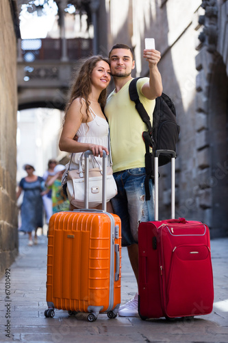 canvas print picture Couple doing selfie at the street