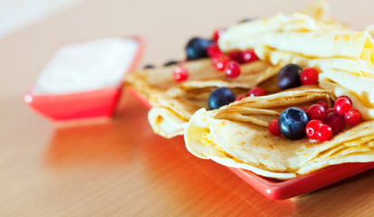 tasty pancakes with cranberries and blueberries
