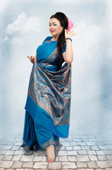 Caucasian woman posing in blue sari
