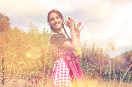 canvas print picture Girl in traditional bavarian dirndl holds beer mug