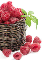 Fresh picked raspberries in a woven basket