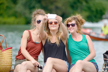 three young women make tourism