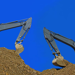 Loading gravel excavators.