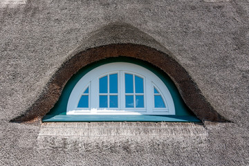 Dormer of a thatched-roof house