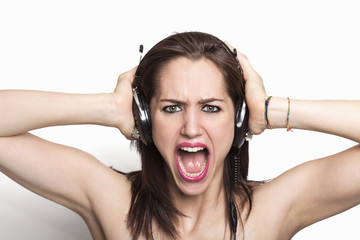 Girl listening to music and screaming