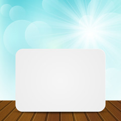 Paper card on sunny background