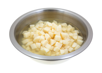 Stainless steel bowl with diced potatoes