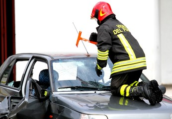 Fire Chief breaks the windshield of the car with a hammer