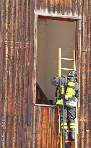 Firefighter with ladder and the oxygen cylinder